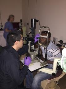 Dr. Lee examining a patient's retina
