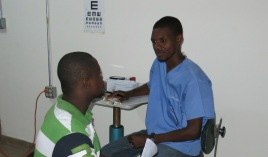 Faustin counseling a patient