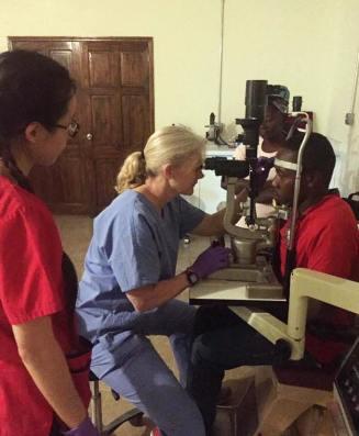 Dr. Lori Geddes at the biomicroscope
