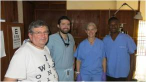 Drs. Mike Hutton, Cliff Brooks and Geddes with Faustin